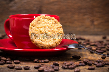 coffee cup with biscuit and coffeebeans