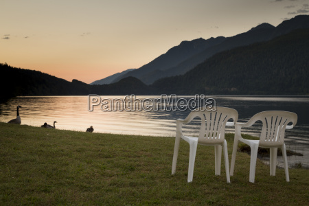 sunrise over lake crescent in log