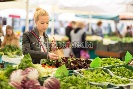 woman buying vegetable at local food