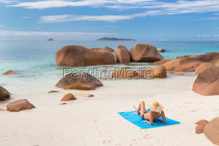 woman sunbathing at anse lazio picture