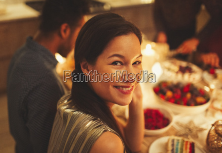 portrait smiling woman at candlelight dinner