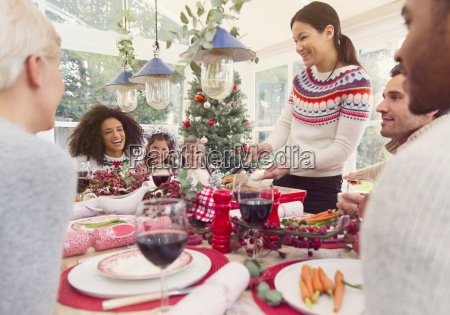 woman serving turkey at christmas dinner