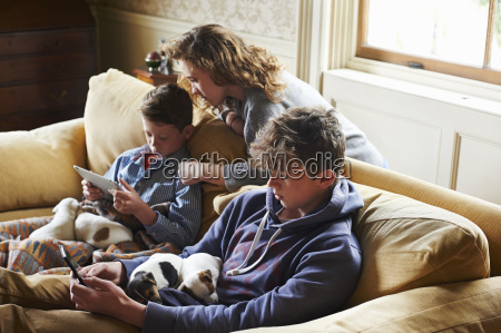 brothers and sister using digital tablet