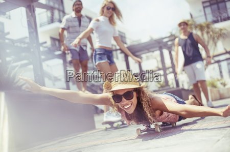 portrait playful young woman laying riding