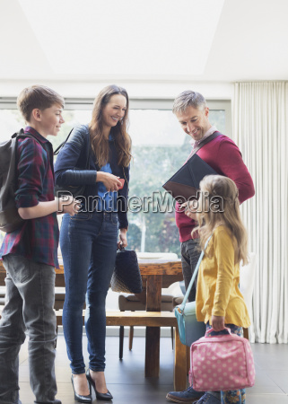 family preparing to leave house in