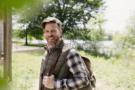 portrait smiling hiker with backpack in