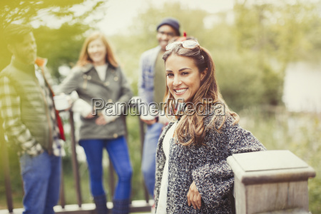 portrait smiling woman with friends on