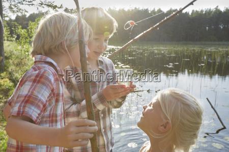 brothers and sister fishing at sunny
