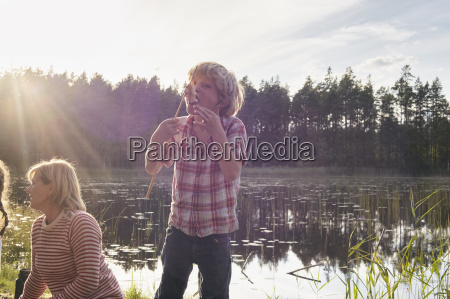 enthusiastic boy eating roasted marshmallows at