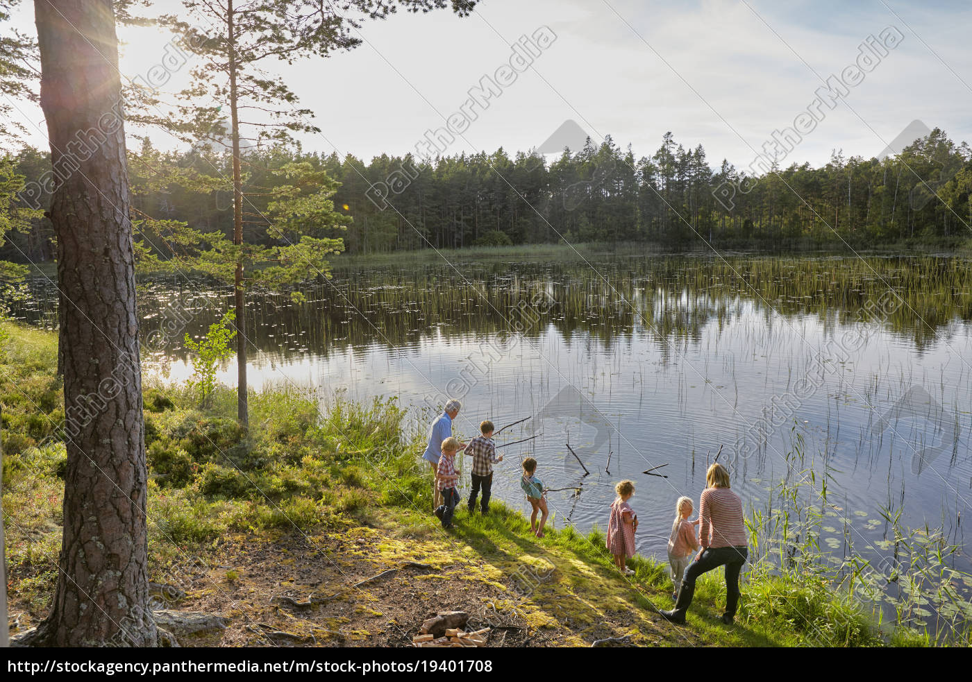 grandparents, and, grandchildren, fishing, at, sunny - 19401708