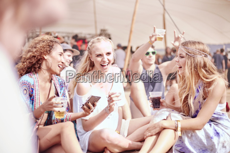 young women hanging out drinking at