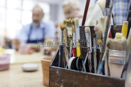 paintbrushes in box in art studio