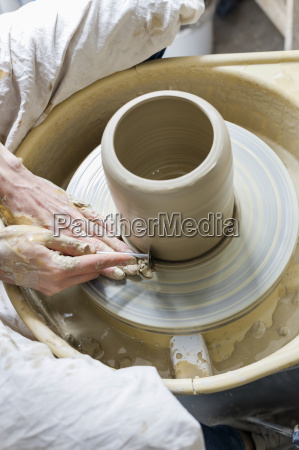 overhead view woman using pottery wheel