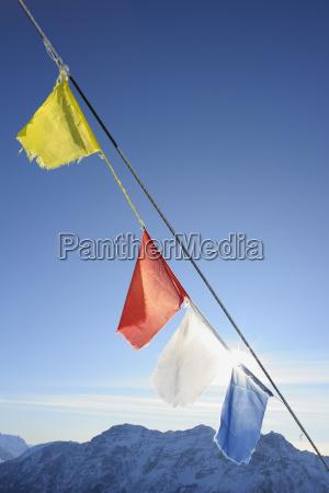 buddhist prayer flags at summit steinplatte