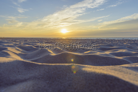 sandy beach at sunrise bunken aalbaek