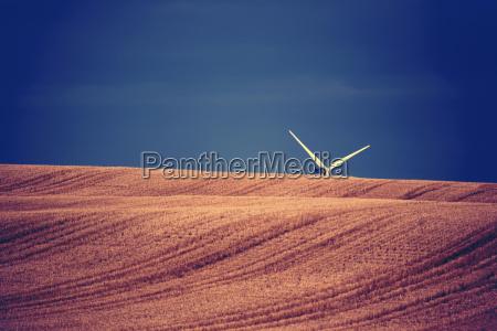 wind turbine blades sticking up above