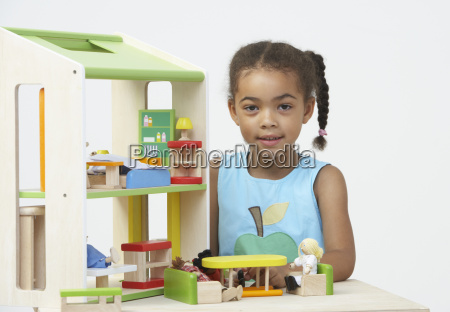 pre school pupil playing with wooden