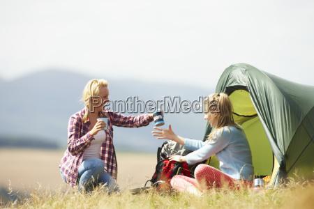 two teenage girls on camping trip