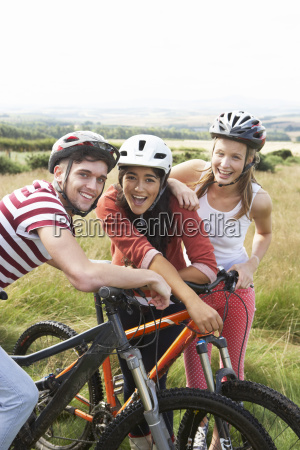 group, of, young, people, cycling, in - 19407546