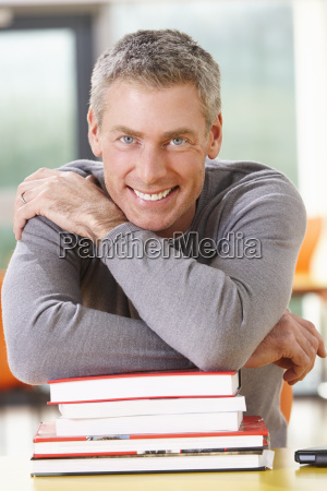 male, mature, student, studying, in, classroom - 19407860