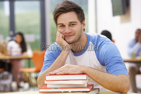 male, student, studying, in, classroom, with - 19407912