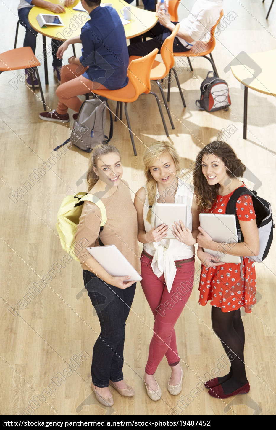 overhead, shot, of, female, students, standing - 19407452