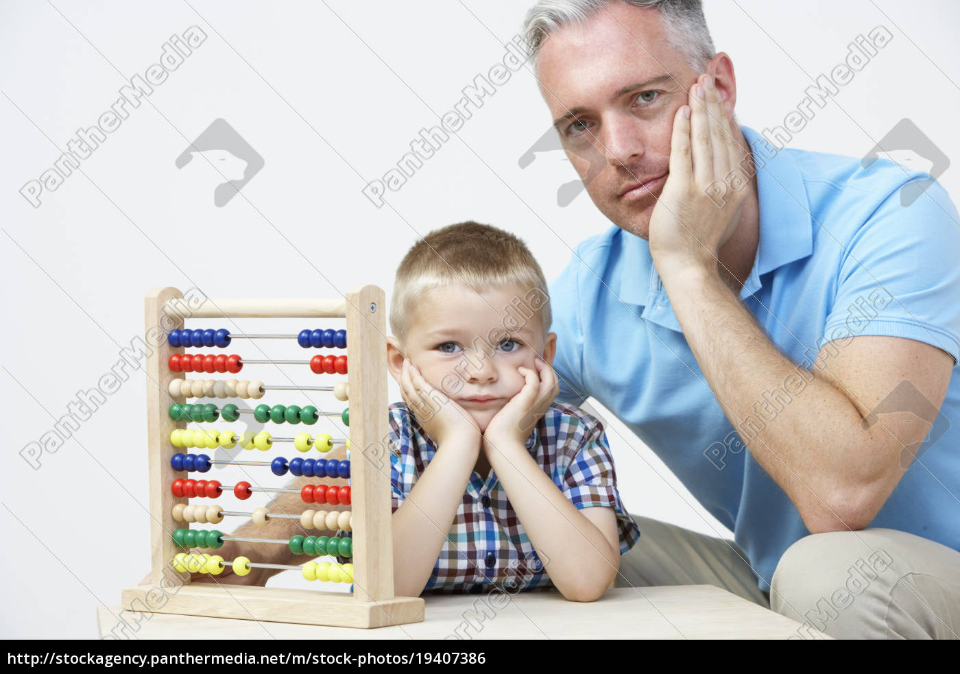 puzzled, father, and, son, looking, abacus - 19407386