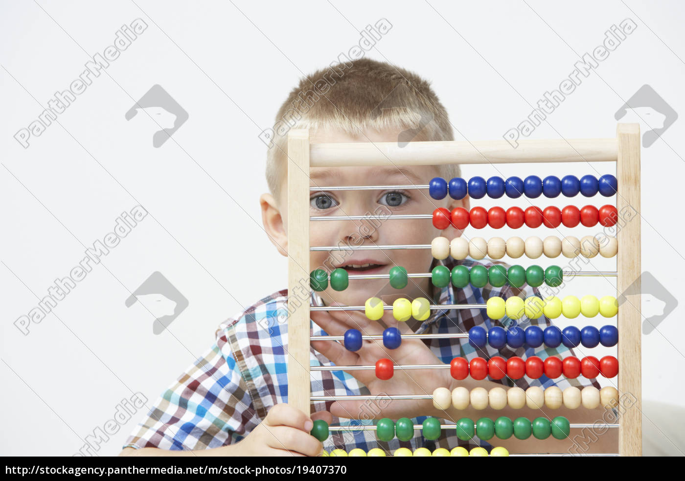 studio, shot, of, boy, playing, with - 19407370