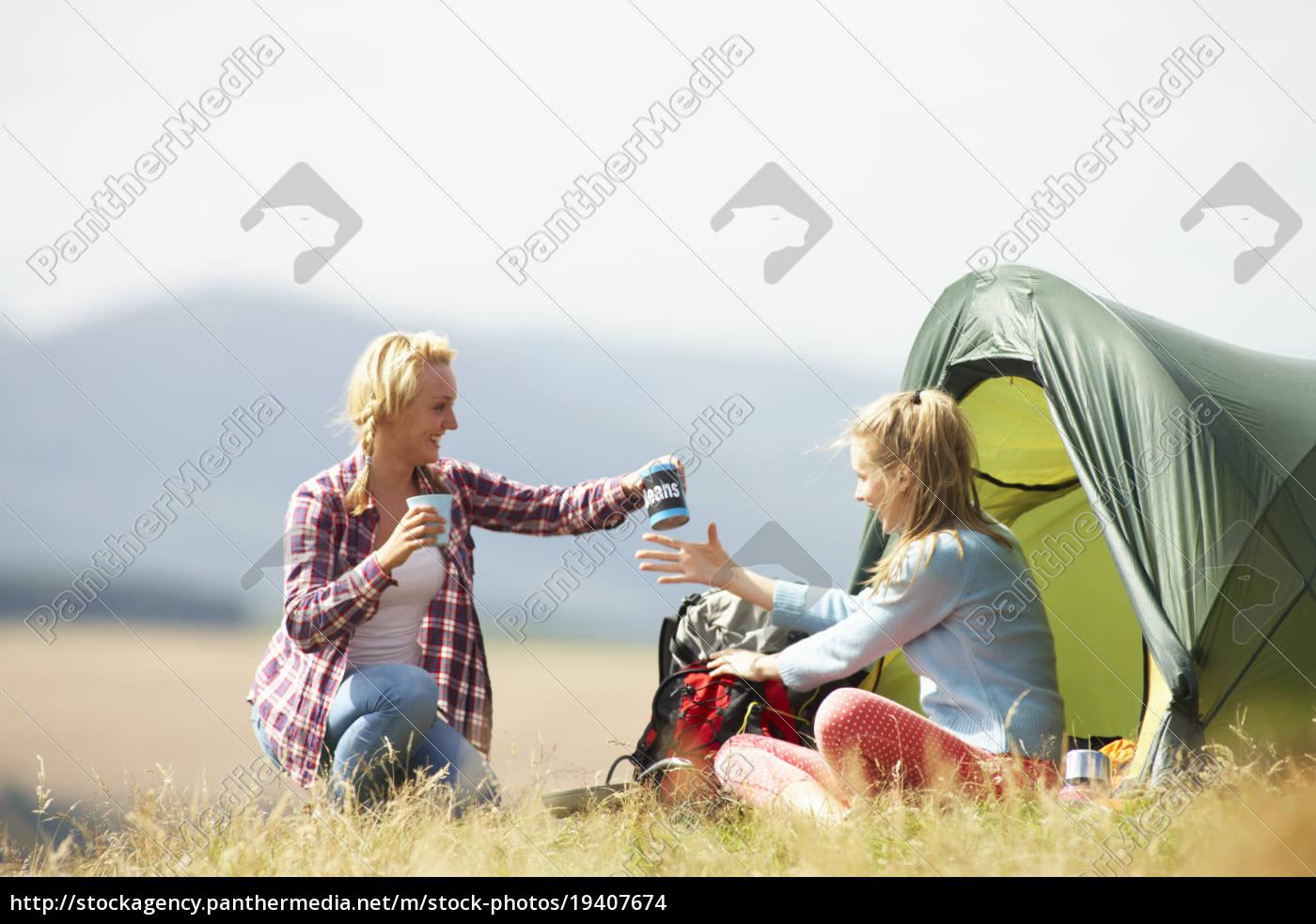 two, teenage, girls, on, camping, trip - 19407674