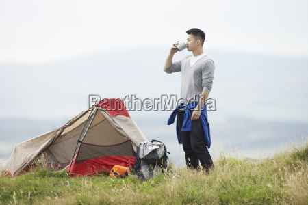 young, man, on, camping, trip, in - 19407612