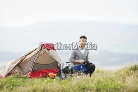 young, man, on, camping, trip, in - 19407624
