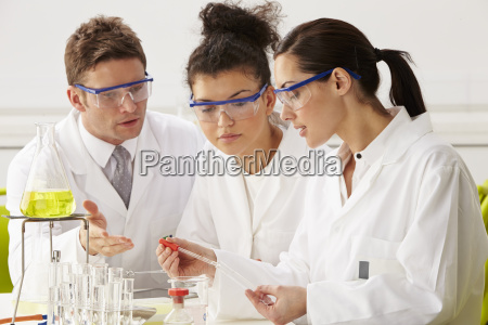 group of scientists performing experiment in