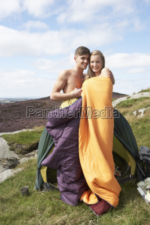 young couple on camping trip in