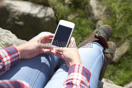 teenage girl using mobile phone in
