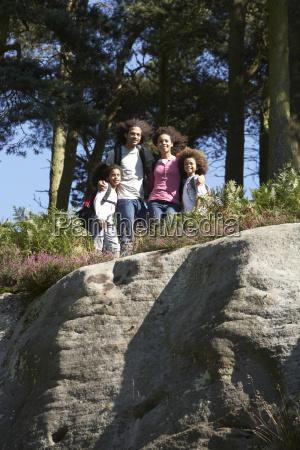 family hiking through countryside