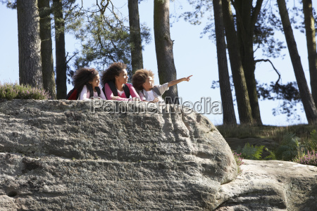 mother and children resting on hike