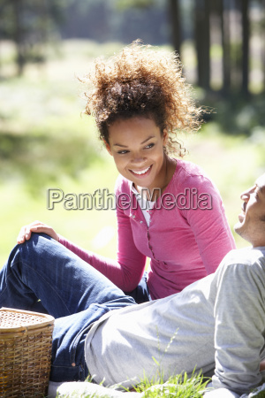 couple having picnic in countryside