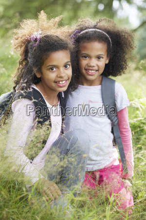 two girls exploring woods together