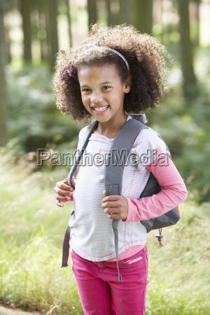 portrait of girl exploring woods