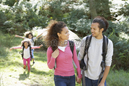family, group, hiking, in, woods, together - 19408806
