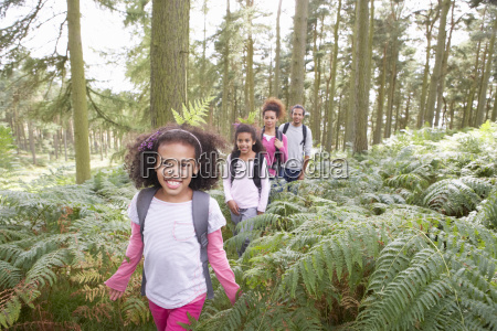 family, group, hiking, in, woods, together - 19408972