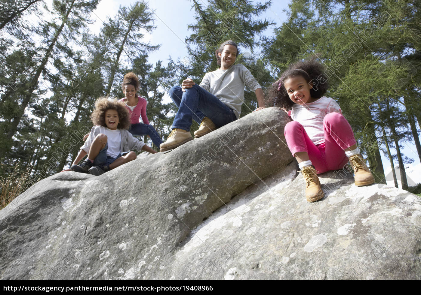 family, group, sitting, on, rock, together - 19408966