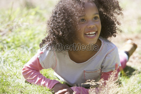 girl, lying, on, grass, in, countryside - 19408824