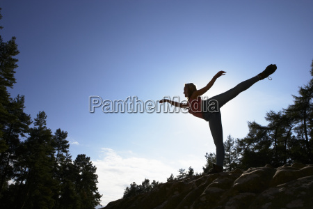 silhouette, of, teenage, girl, balancing, on - 19408694