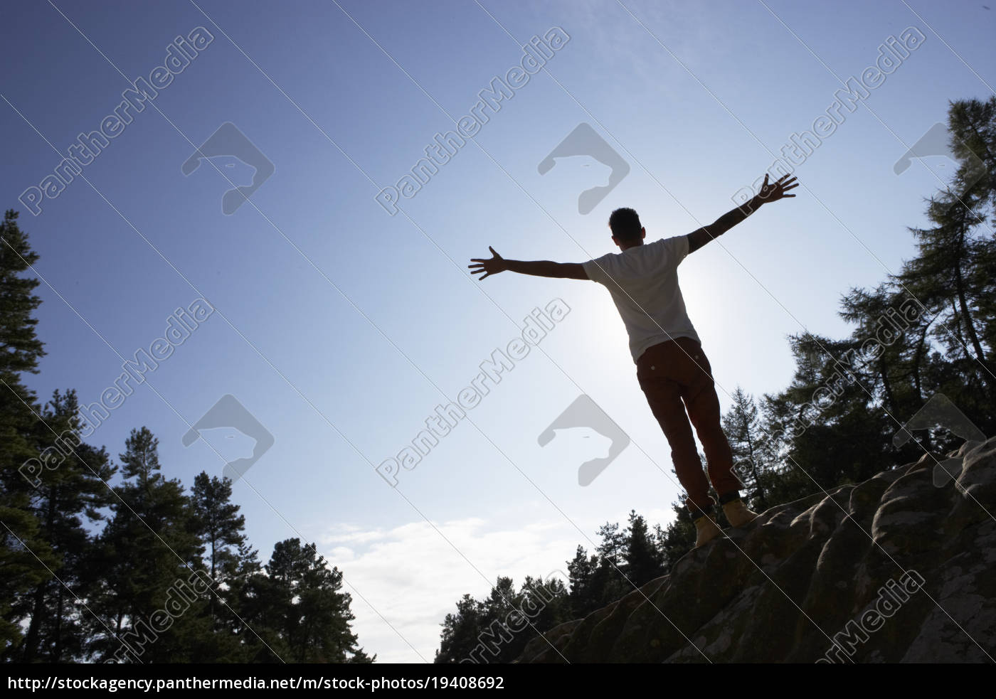 silhouette, of, young, man, standing, on - 19408692