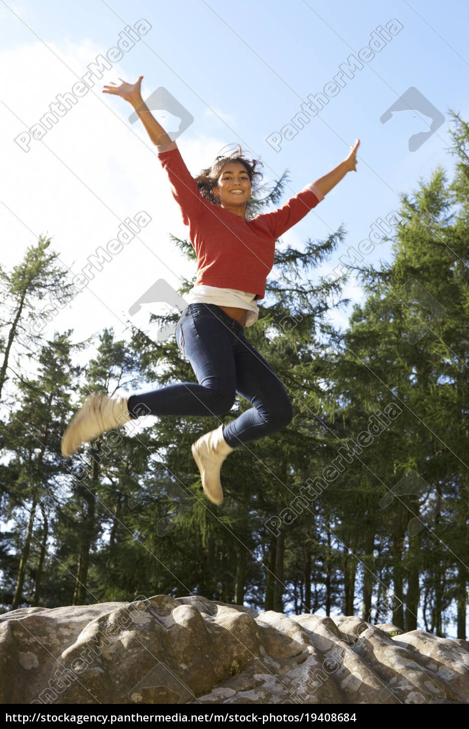 teenage, girl, leaping, in, air, outdoors - 19408684