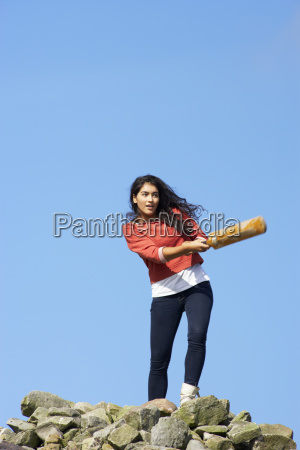 teenage, girl, playing, cricket, outdoors - 19408624