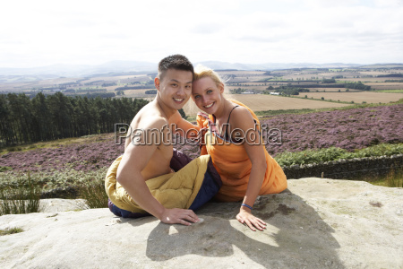 young, couple, in, sleeping, bags, admiring - 19408586