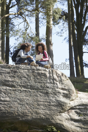 young, couple, resting, during, countryside, hike - 19408782