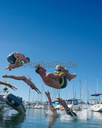 digitally multiplied people diving and somersaulting